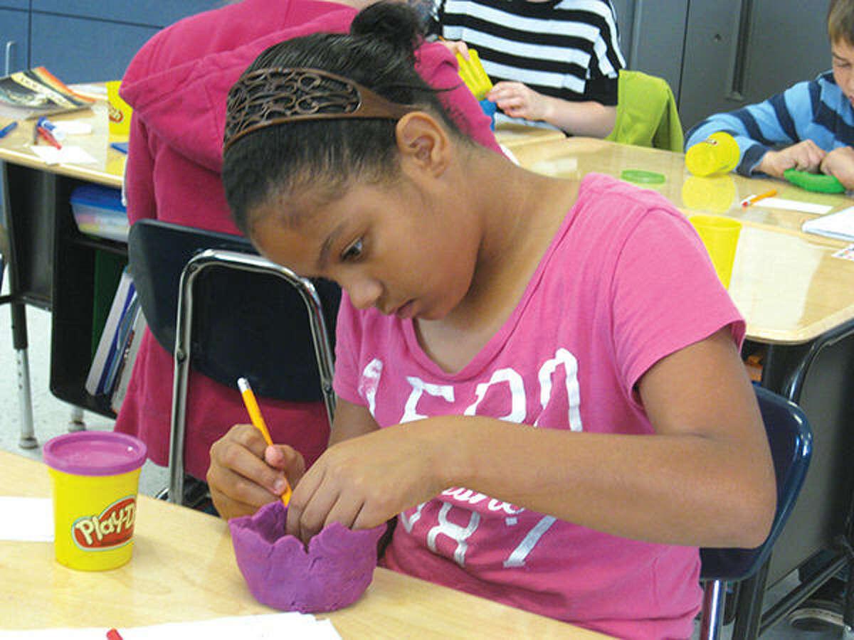 Kayla Rowzeeworks on her pencil holder in Matthew Aken's classroom.
