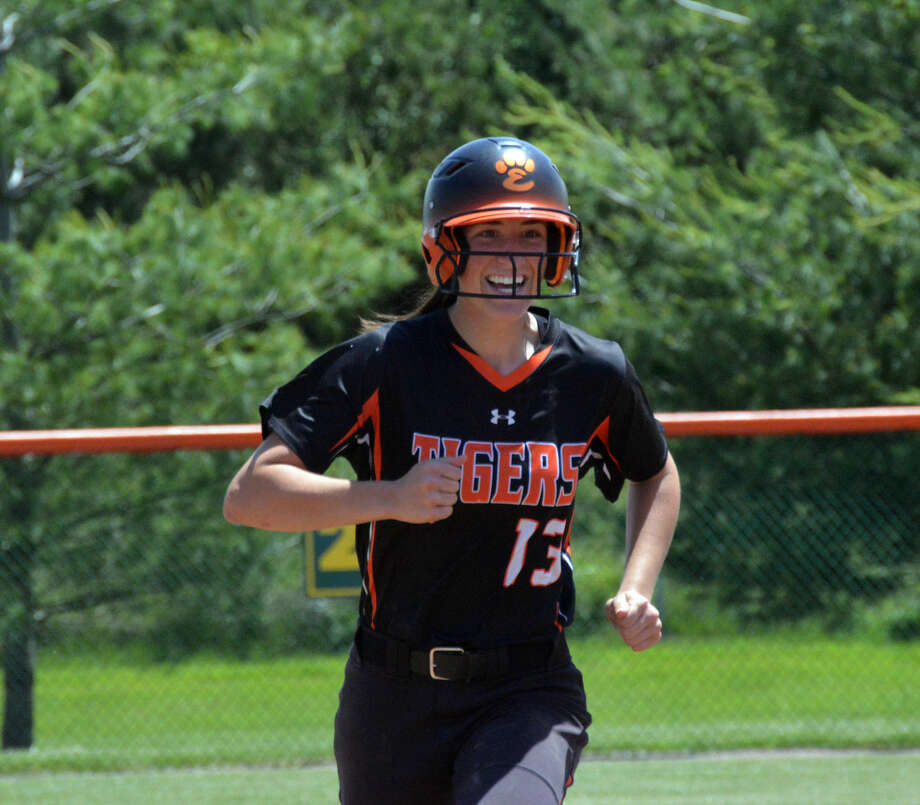 EHS center fielder Sarah Hangsleben can't help but smile as she rounds the bases.