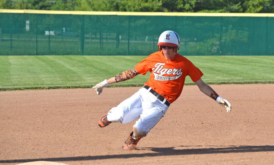Edwardsville's Will Messer advances to third base on an error during the sixth inning of Tuesday's home game against Belleville East.