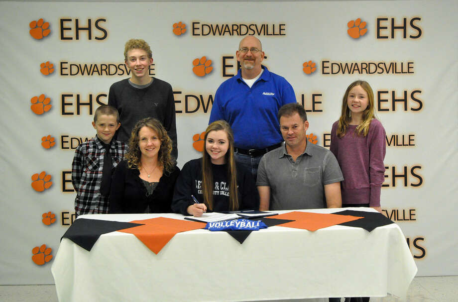 Edwardsville senior Cassie Allen recently signed to play volleyball at Lewis and Clark Community College. Seated, left to right, Kellie Allen, mother, Cassie Allen and Doug Allen, father. Standing, left to right, Ben Allen, brother, Nick Allen, brother, LCCC head coach Jim Hunstein and Jillian Allen, sister.