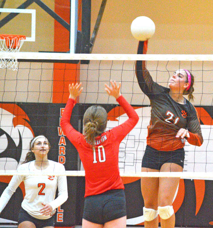 Edwardsville sophomore Rachel Pranger, right goes up for a kill against Visitation's Abby McClure in Tuesday's match at Lucco-Jackson Gymnasium.