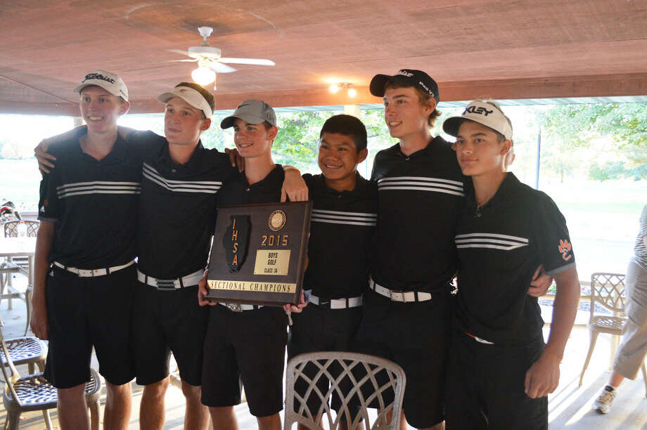The Edwardsville boys' golf team displays the championship plaque after winning Monday's Class 3A Alton Sectional at Spencer T. Olin Golf Course.