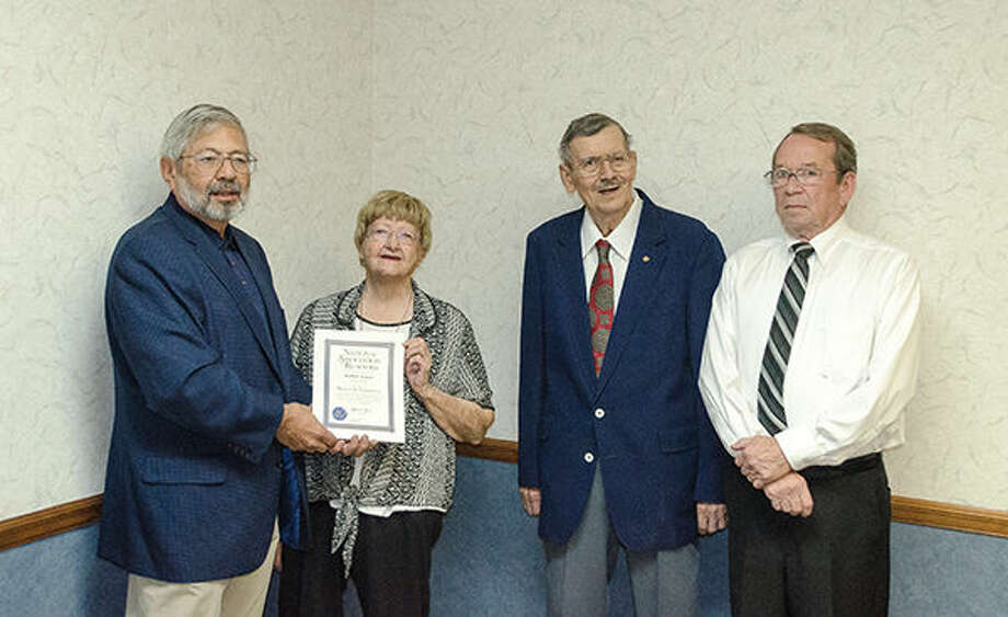 From left: Al Suguitan, Esther Kacer, Larry Kacer and Bob Rohrkaste.Al Sugitan presents Esther Kacer with an award from the National Association of Realtors for 40 years of dedicated service in the Real Estate industry. Photo by Matt Winte.
