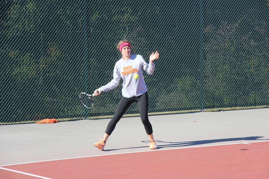 Edwardsville senior Callaghan Adams returns a serve in her championship match against teammate Natalie Karibian.
