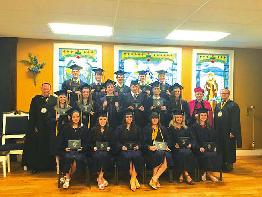 The 17 senior graduates and other school and church officials at Father McGivney Catholic High School's first graduation. Photo: For The Intelligencer