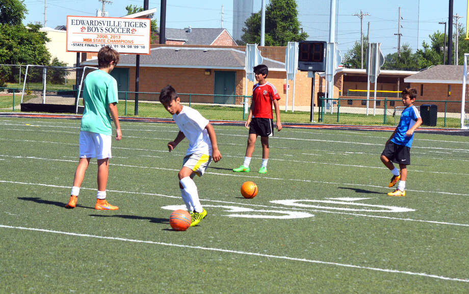 Campers perform a possession drill on Friday during the final day of the Edwardsville High School boys' soccer camp.
