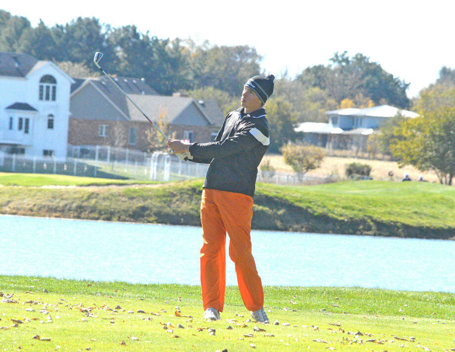 Edwardsville senior Justin Hemings watches the flight of his second shot from hole No. 6 in Saturday's second round of the Class 3A state tournament at the Den at Fox Creek Golf Course in Bloomington.