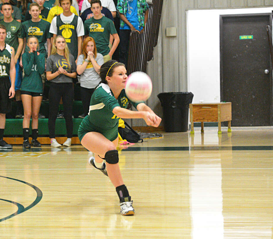 Metro-East Lutheran senior Ashley Sola receives a serve during Wednesday's home match against Roxana.