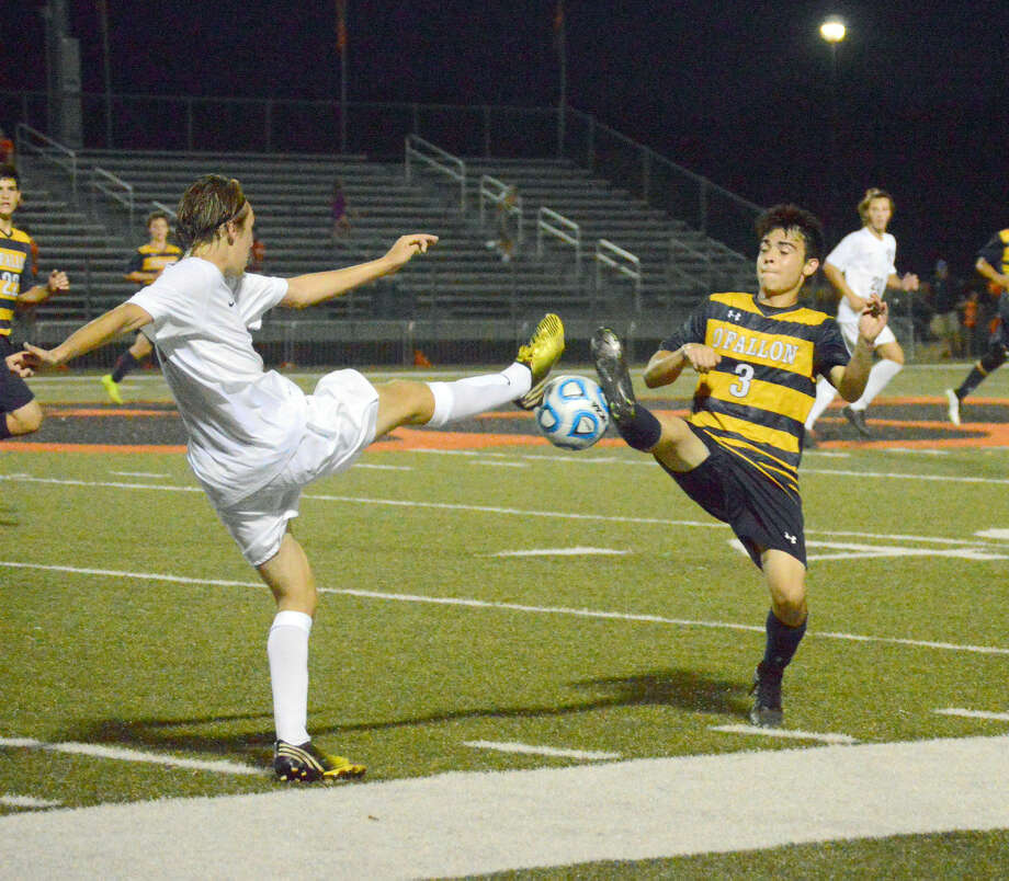 Edwardsville's Bayne Noll, and O'Fallon's Noah Macias battle for a ball during the regular season game on Sept. 3 at the District 7 Sports Complex.