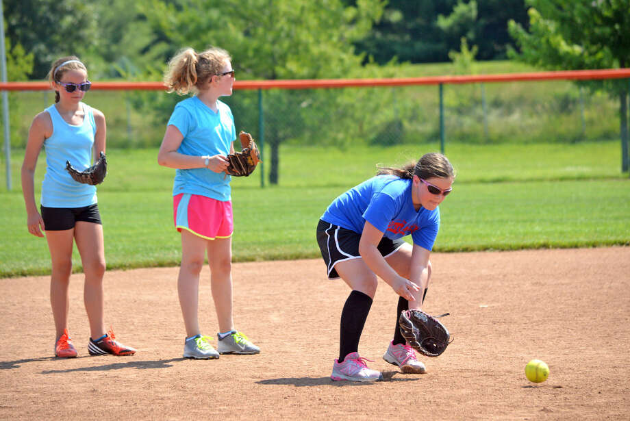 Campers perform fielding drills on Monday during the opening day of the Edwardsville High School softball camp at the EHS Sports Complex.