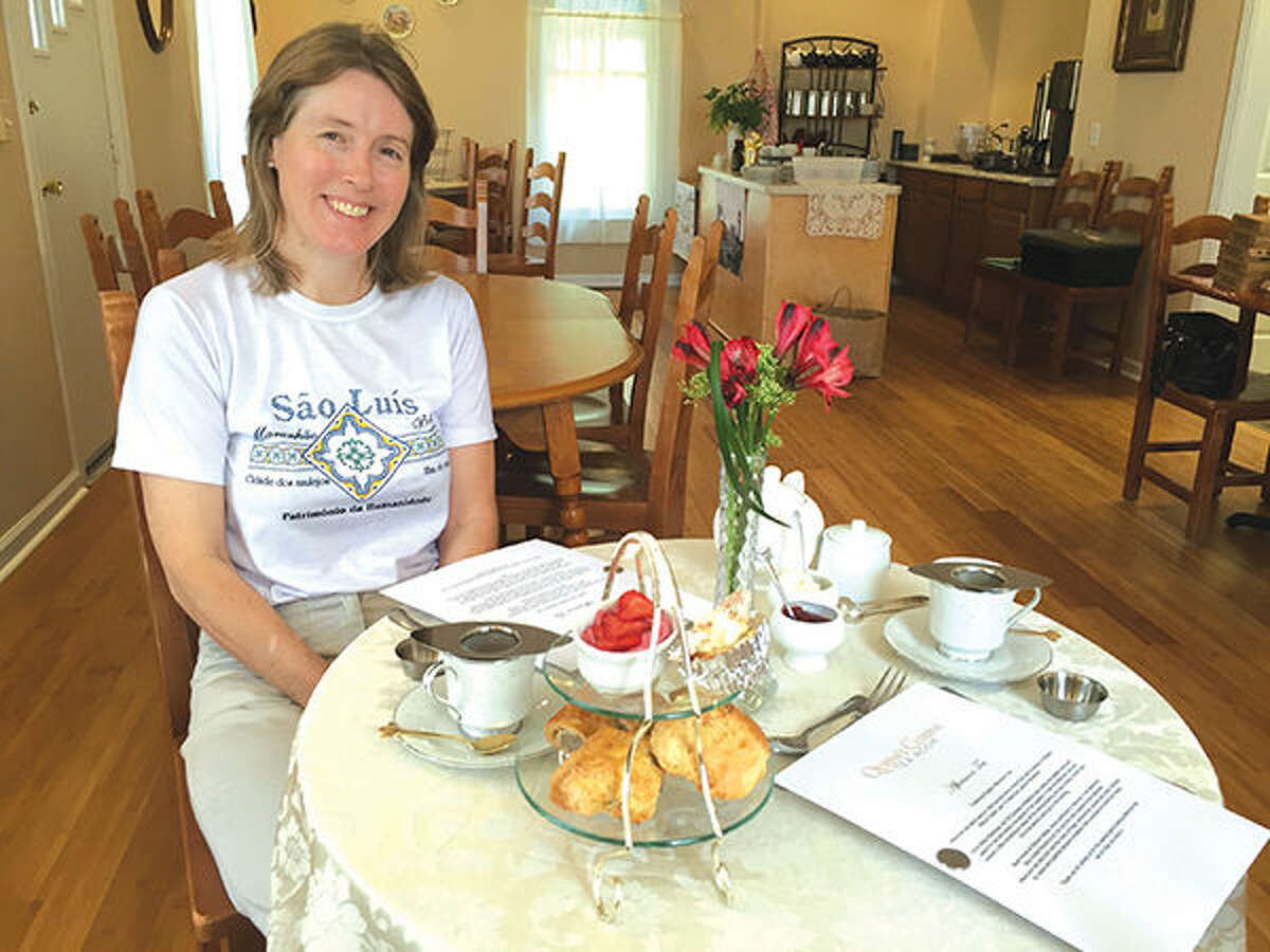 Jane Muscroft sits inside the Queen's Cuisine Tea Room, which opened today at 120 South Main Street in downtown Edwardsville.