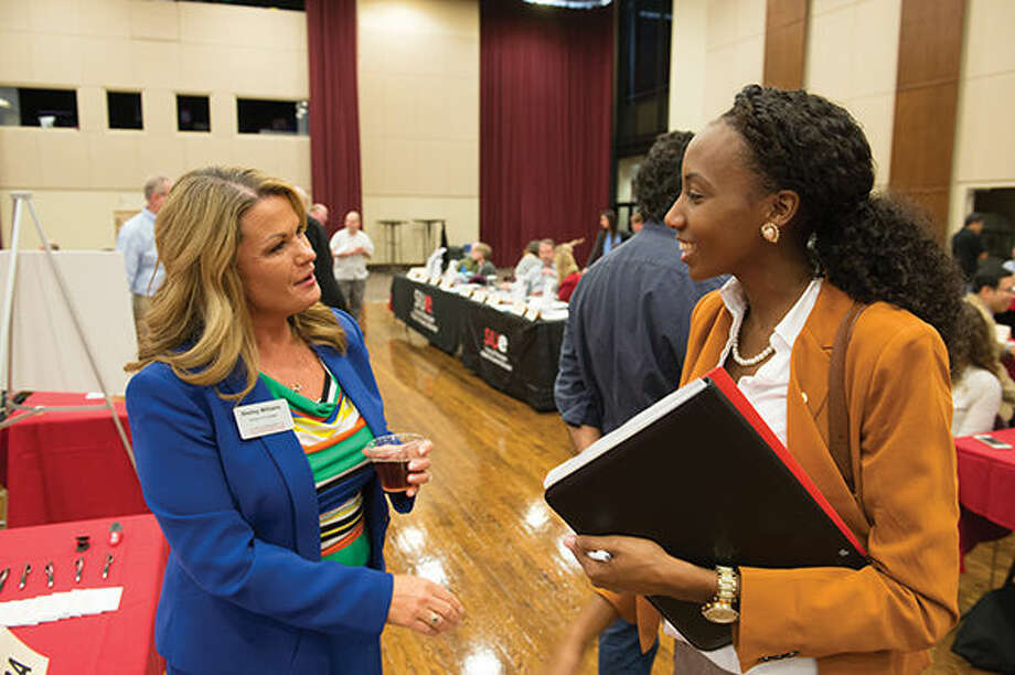 Shelley Williams with the SIUE School of Business, left, discusses the master's in business administration with Paula Clarke, of Chicago. Photo: SIUE Photo