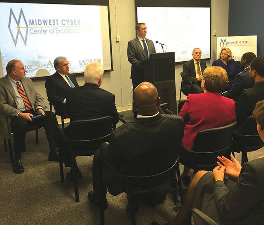 Jason Carter, president of Aegis Strategies, LLC, addresses the crowd at the news conference announcing the new Midwest Cyber Center of Excellence, flanked by fellow speakers. Photo: For The Intelligencer