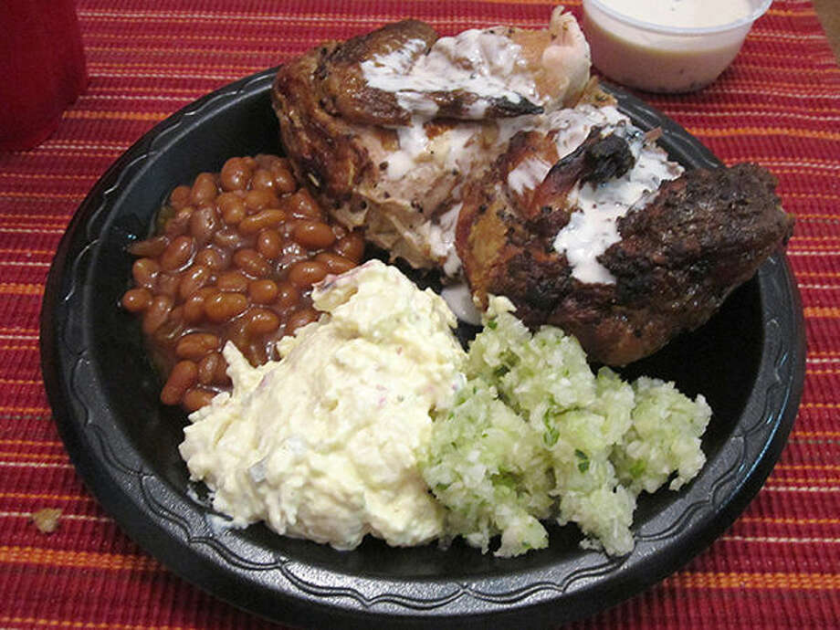 Smoked chicken drizzled in Alabama white sauce, cole slaw, red-skinned potato salad and kettle baked beans from Big Bob Gibson's Bar-B-Q in Decatur, Ala. Photo: Bill Roseberry/The Edge