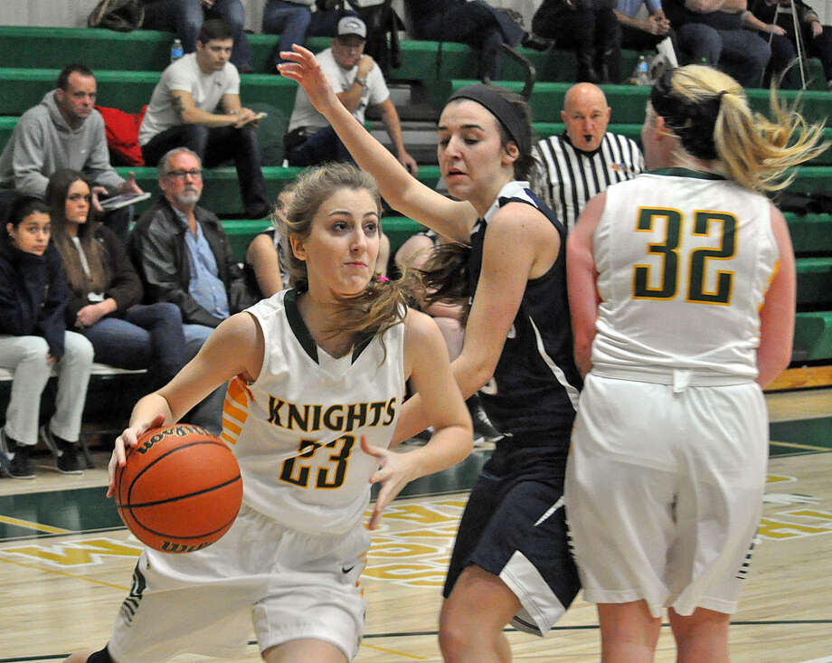 Metro-East Lutheran guard Audrey Paitz, left, dribbles around a defender on Friday.