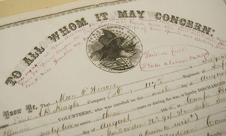 A closeup of Civil War-era discharge notice for one Alson Weaver, currently stored at the Madison County Recorder's Office. Madison County Recorder Amy Meyer and Historical Preservation Specialist Casey Weeks are working to digitize about 140 Civil War discharge records in their holdings.