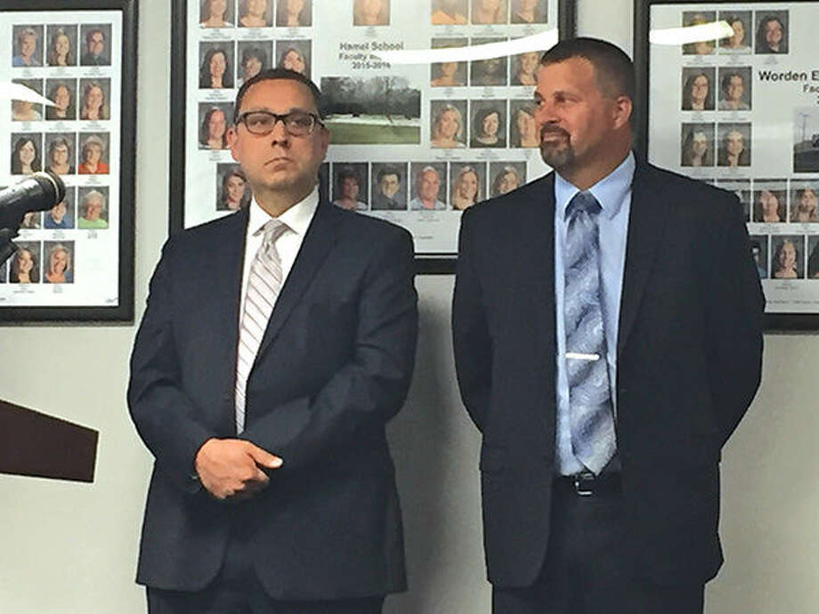 Edwardsville District 7 administrators Andy Williams, left, and Vince Schlueter were honored for earning their doctorate degrees at Monday's Board of Education meeting. Photo: Julia Biggs/Intelligencer