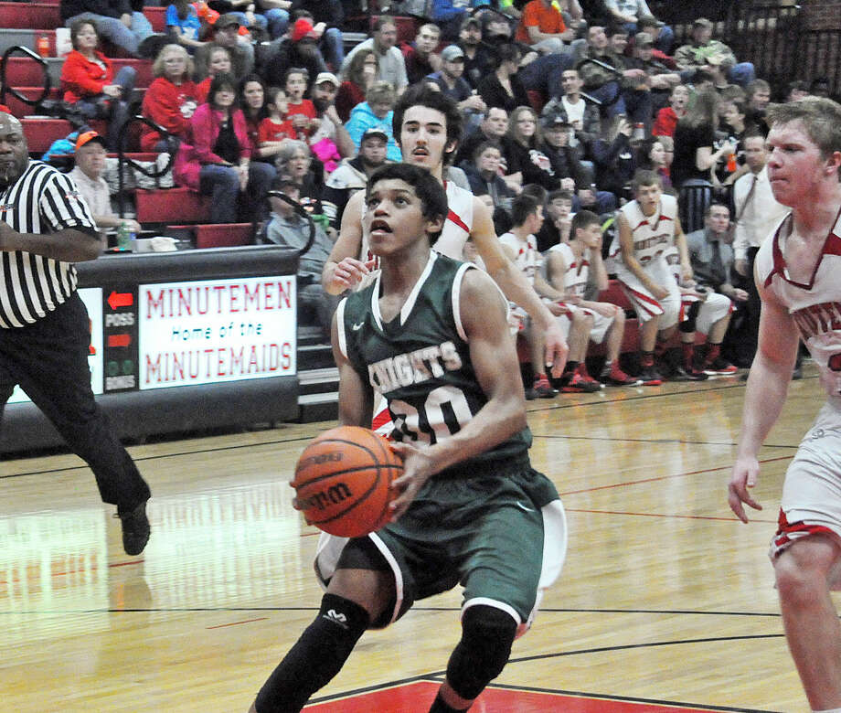 Metro-East Lutheran junior guard Teddy Fifer goes in for a layup during third-quarter action against Bunker Hill.