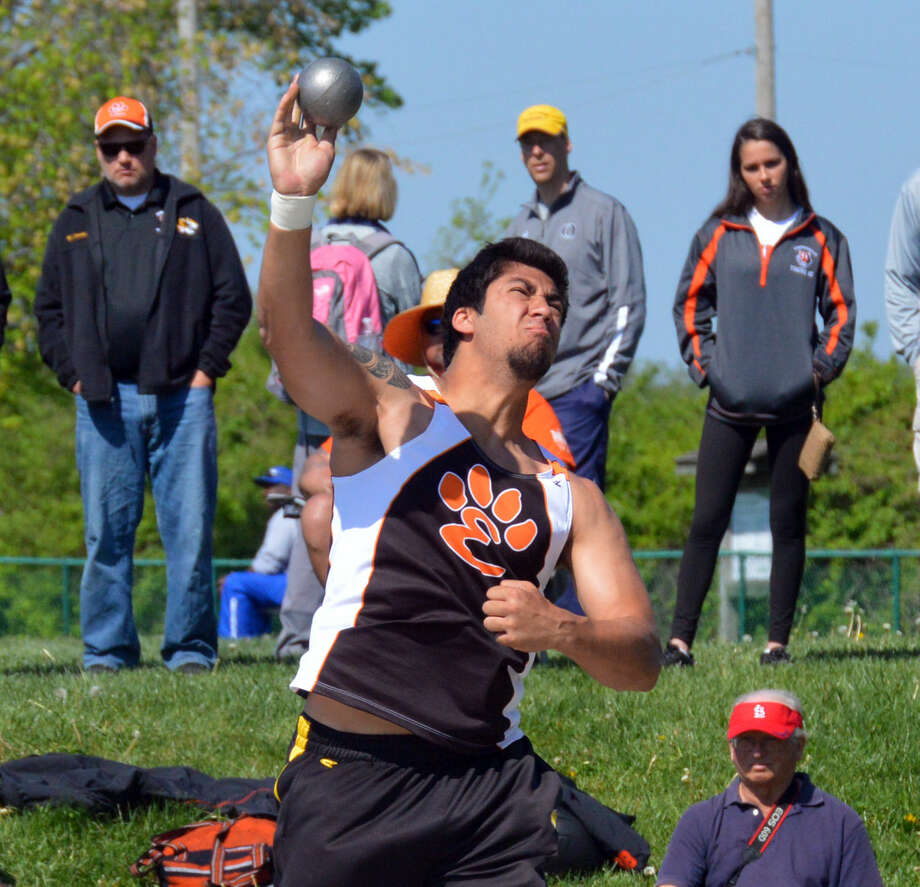 Edwardsville's AJ Epenesa throws the shot put.