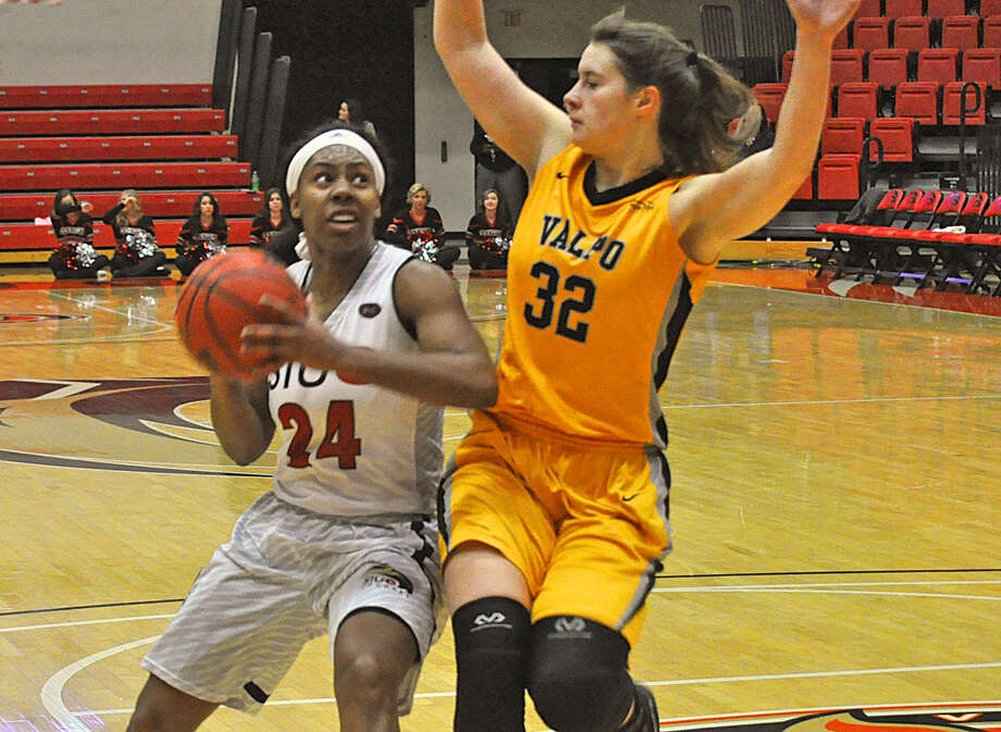 SIUE senior forward Tierny Austin, left, goes up for a shot with Valparaiso's Dani Franklin defending her midway through the first half.
