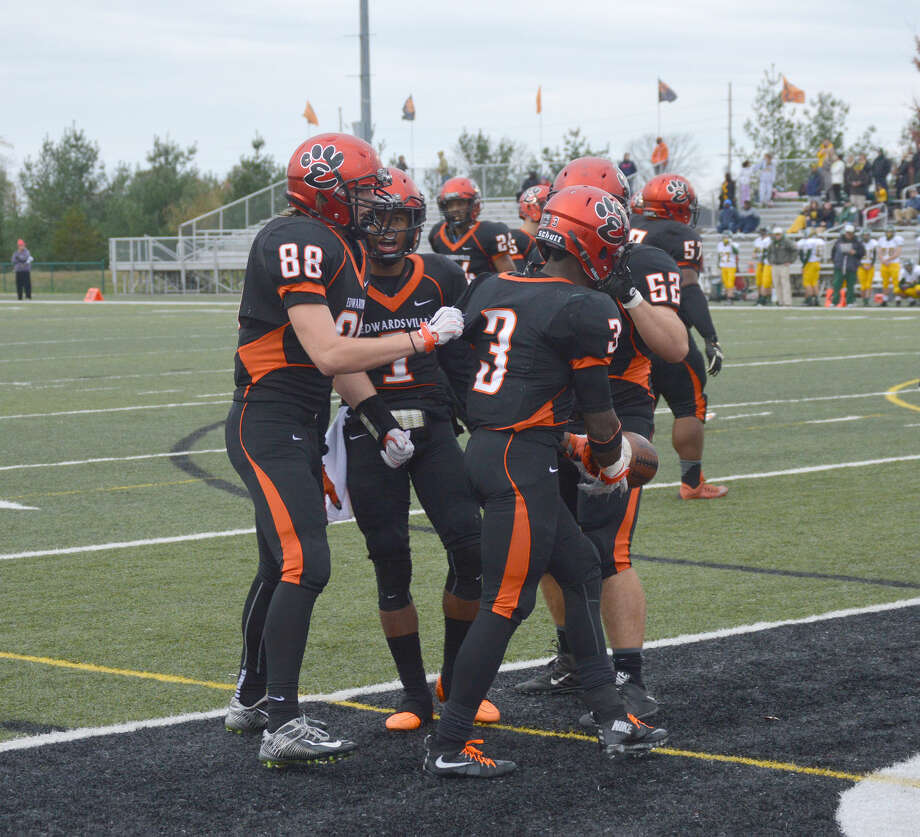 Edwardsville celebrates after running back Kendell Davis scores in the fourth quarter against Waubonsie Valley.