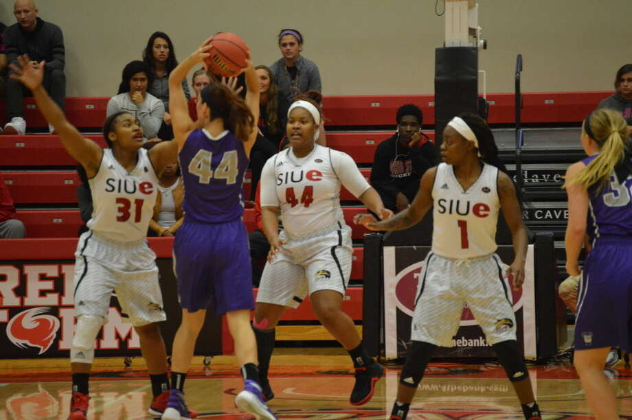 SIUE's Donshel Beck (31), Gwen Adams (44) and Coco Moore step up on defense during the exhibition against Truman State.