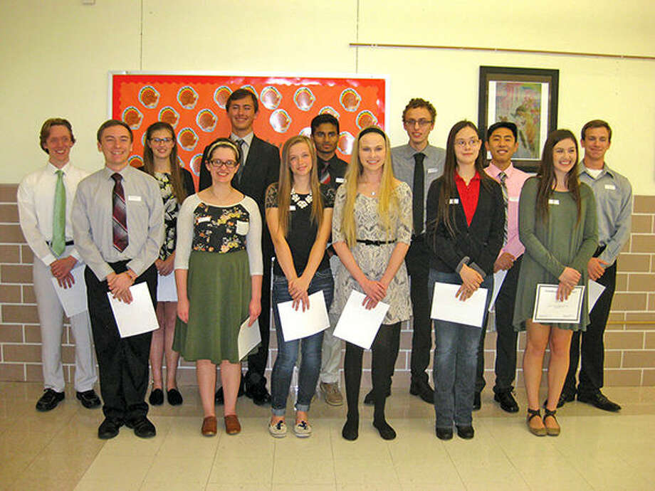 EHS students honored recently for academic achievements by the Edwardsville District 7 Board of Education are in front, from left: Matthew Morse, Gwyneth Cross, Amanda Schmidt, Sophia Evans, Olivia Cho and Kayla Johnson. In back are, from left: Eden Vitoff, Margaret Anderson, Erik Andersen, Pradeep Kandula, Will Jeziorski, Henry Lu and Jeff Schulz. Not pictured is Rachel Schoenecker. Photo: Julia Biggs/Intelligencer