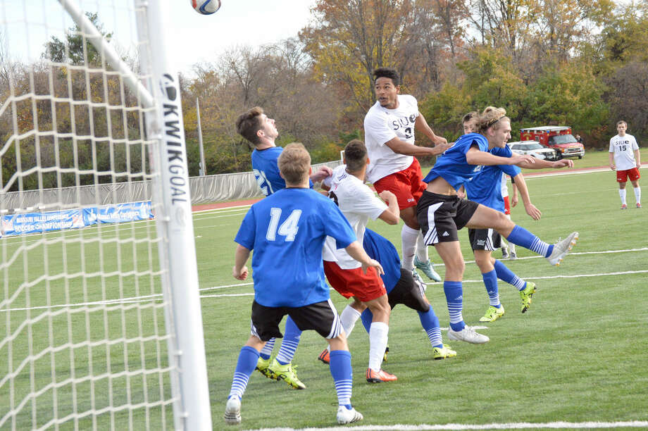 SIUE senior midfield Jabari Danzy, right, puts a header on goal late in the second half against Drake during the Missouri Valley Conference championship game.