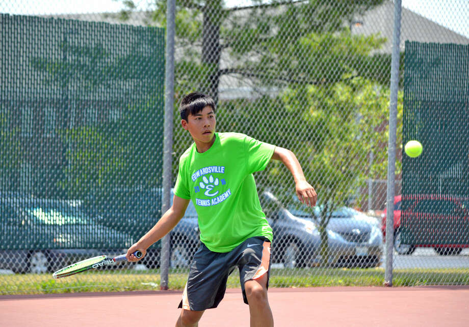 Jason Pan, who will be a junior at Edwardsville, makes a forehand return during his boys' 16 singles consolation championship match on Sunday at the Tiger Tennis Classic.