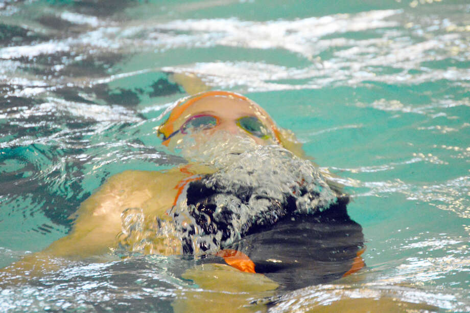 EHS junior Bailey Grinter prepares to come up for air after her final turn during the 100-yard backstroke.