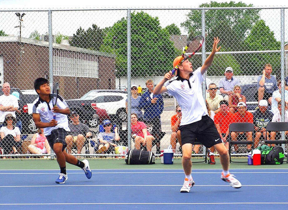 Edwardsville sophomore Alex Gray (right) prepares to hit an overhead shot as his doubles partner, freshman Zach Trimpe, looks on during the state tournament. Photo: Gardner Holland Photo