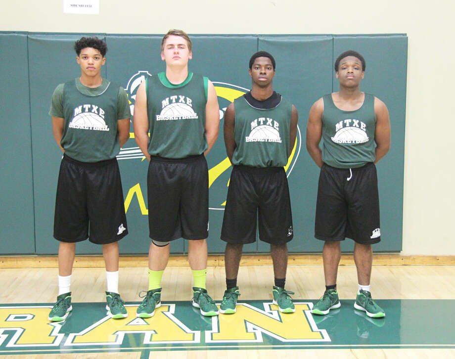 The senior members of the MELHS boys' basketball team from left to right are Teddy Fifer, Jason Johnson, Elijah Culbert and Anthony Spiller.