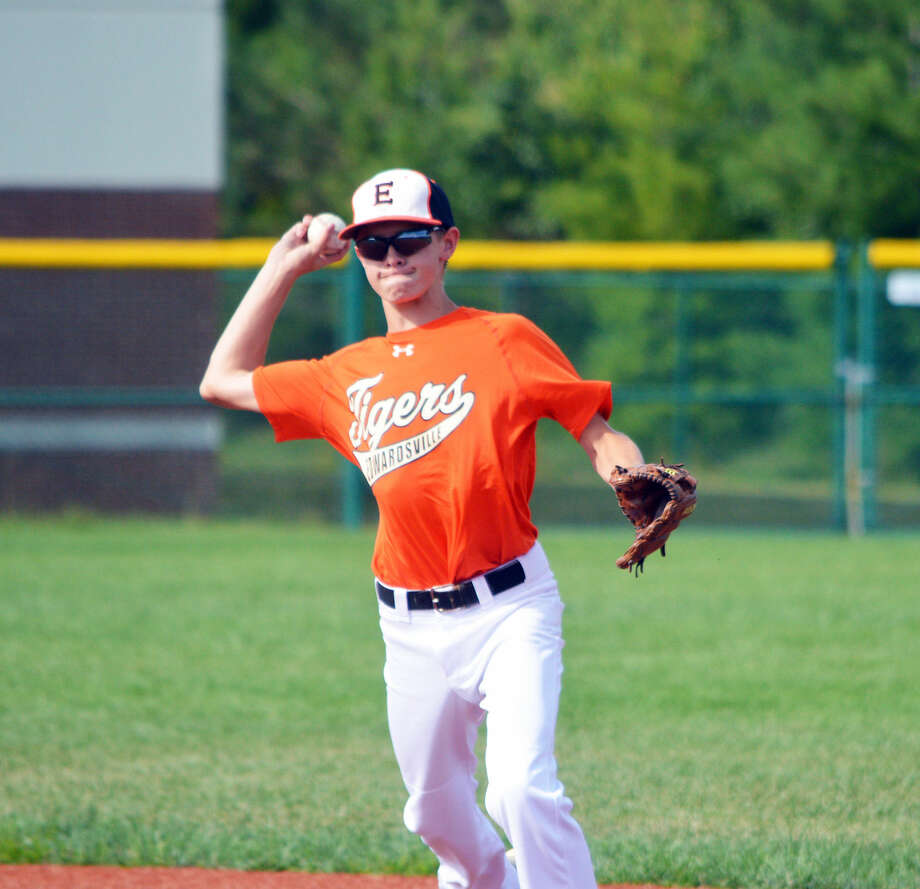 Edwardsville second baseman Blake Burris throws to first base for an out during the third inning.