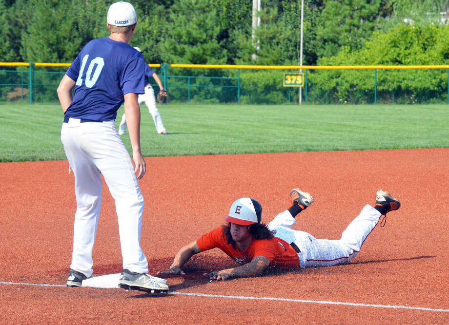 Edwardsville's Daniel Picchiotti slides safely into third base after a base hit in the fourth inning.