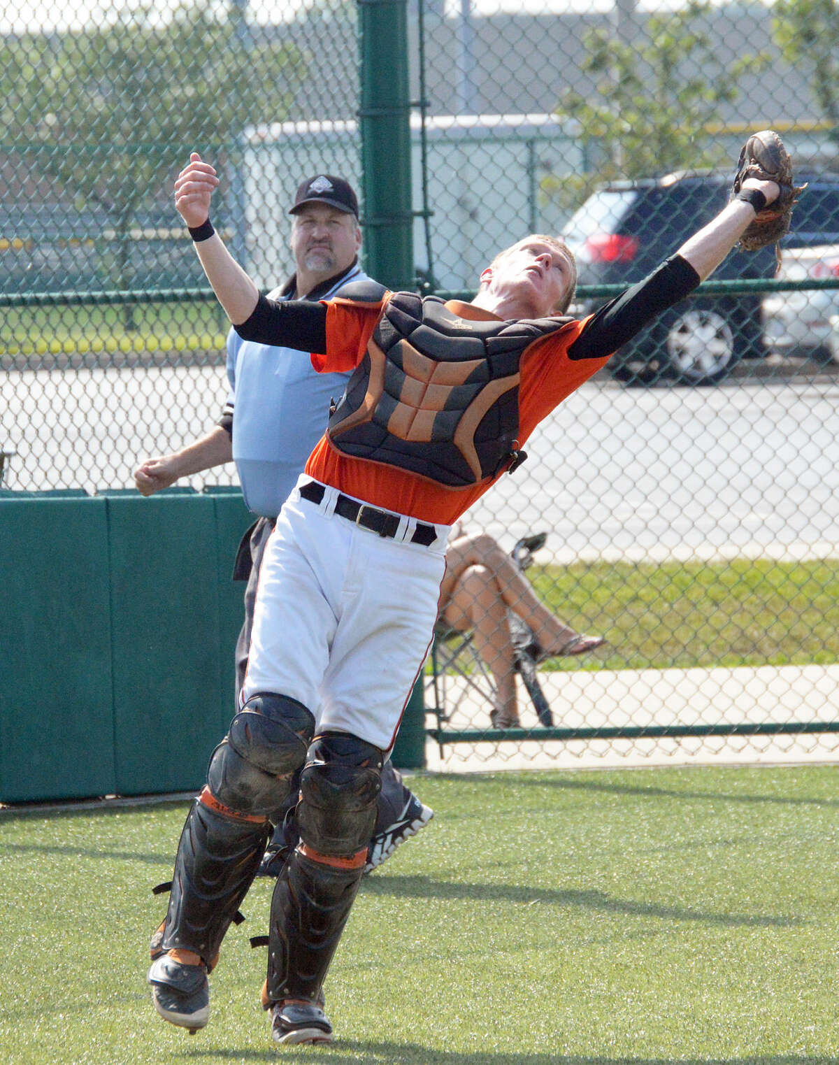 EHS catcher Will Messer leans back to grab a foul ball for an out.