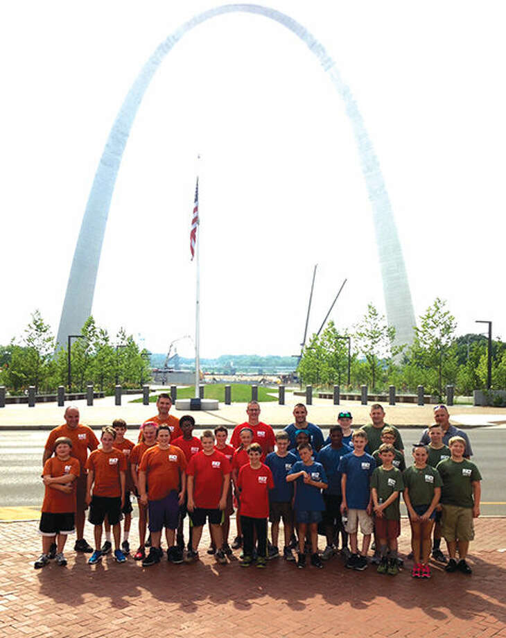 Police and Children Together campers and Metro East officers enjoy a day at the Arch.
