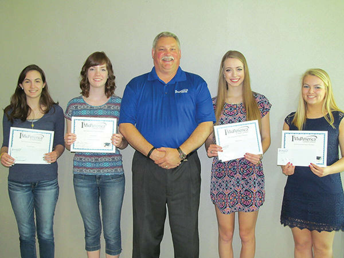 Scholarship recipients receive certificates of achievement from Alan Meyer, President and CEO of 1st MidAmerica Credit Union. Pictured left to right: Adrinnah Ferguson, Emily Duncan, Alan Meyer, Megan Grove, and Margaret Tepen.