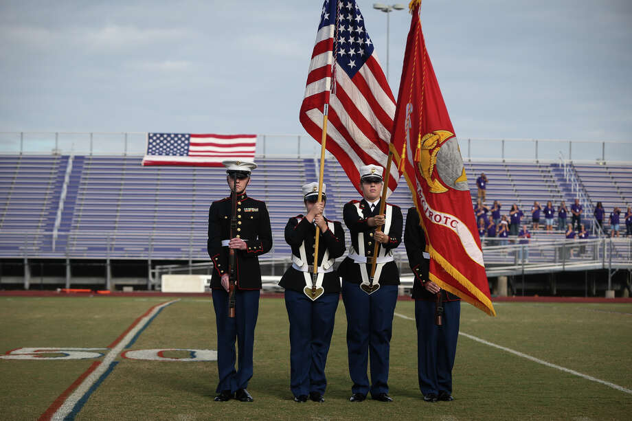 Montgomery Marine JROTC honor guard presents the colors for the national anthem during the Veterans Day Celebration on Tuesday, Nov. 1, 2016, at Bears Stadium in Montgomery. Photo: Michael Minasi, Staff / © 2016 Houston Chronicle