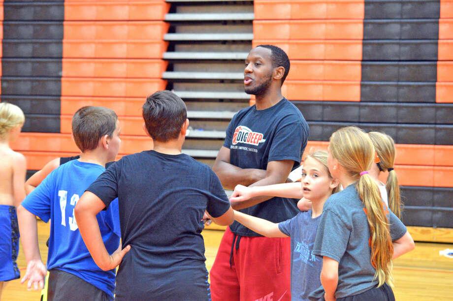 Former Edwardsville High School standout Brandon Hogg returned home to help run a camp at Lucco-Jackson Gymnasium.