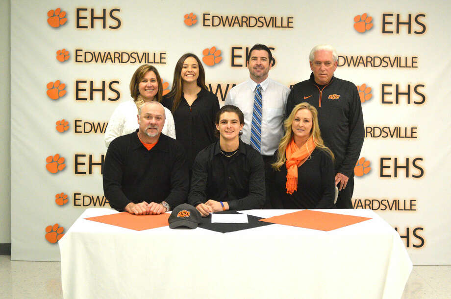 Edwardsville senior Trey Riley recently signed with Oklahoma State to continue his baseball career. Seated left to right are P.J. Riley, Trey Riley and Gina Riley. Standing behind from left to right are Becky Sarabia, Taegan Riley, Tim Funkhouser and Dave Scott.