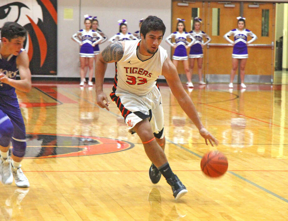Edwardsville junior A.J. Epenesa drives to the basket during Friday's Southwestern Conference game against Collinsville at Lucco-Jackson Gym.