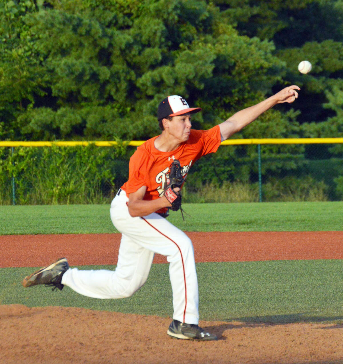 Edwardsville pitcher Isaac Garrett delivers a pitch to a Greenville hitter during the third inning Wednesday at the junior varsity field.