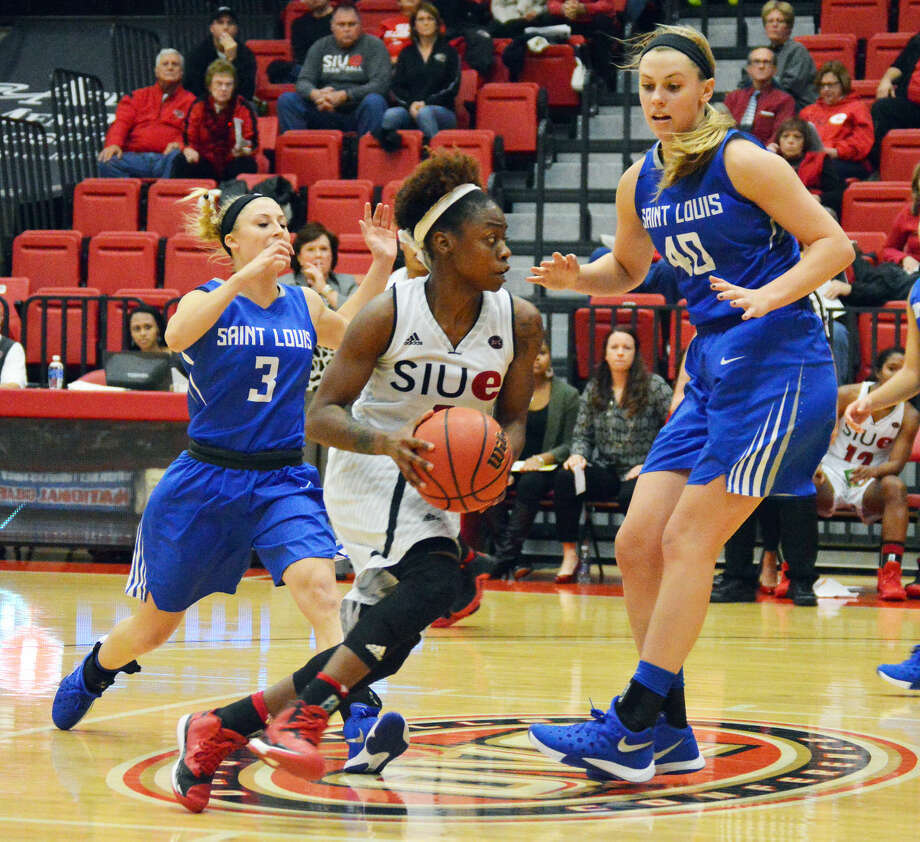 SIUE's CoCo Moore drives past SLU's Sadie Stipanovich in Monday's contest at the Vadalabene Center.