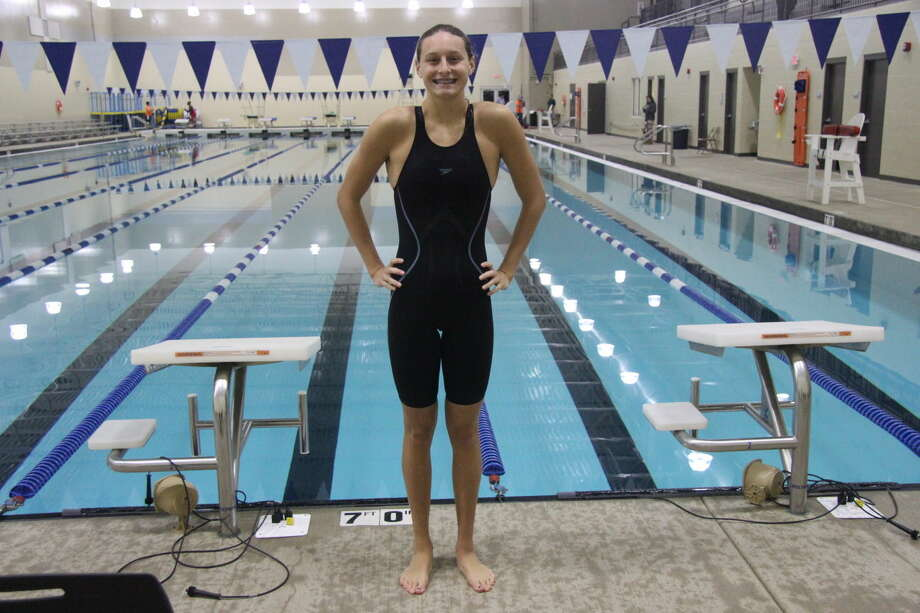 Edwardsville junior Bailey Grinter qualified for the Olympic Trials in her second event on Friday night at the Chuck Fruit Aquatic Center.