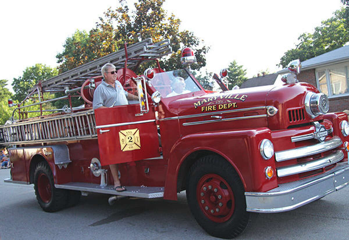 Maryville Village Board Trustee Ed Kostyshock drives the village's historic fire truck during a previous parade. This year's homecoming begins tonight.