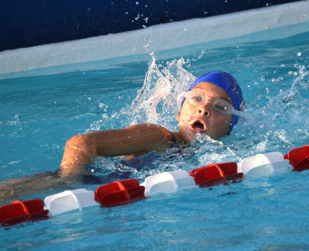 Water Works swimmer Alison Brase competes in the second heat of the girls 9-10 50-meter freestyle during Thursday's meet against the Paddlers.