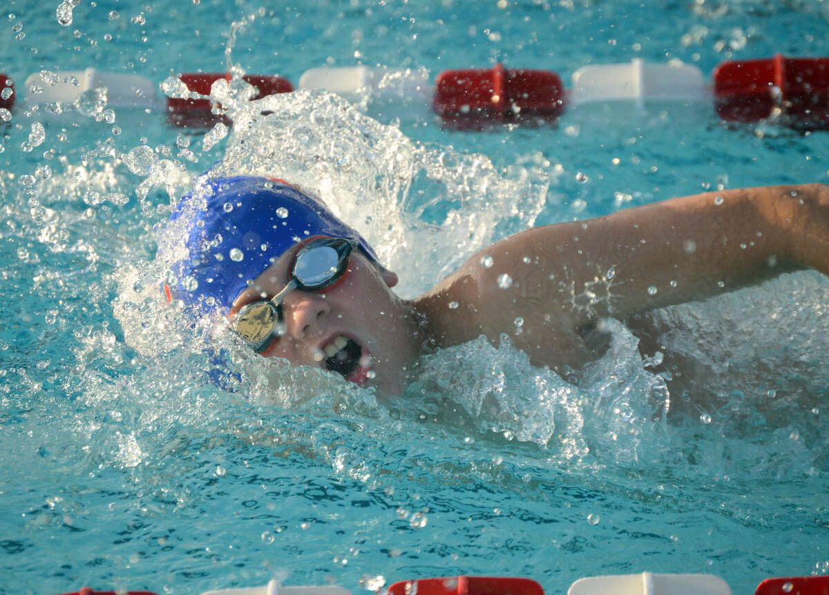 Water Works swimmer Luke DeConcini competes in the second heat of the boys 9-10 50-meter freestyle during Thursday's meet against the Paddlers.