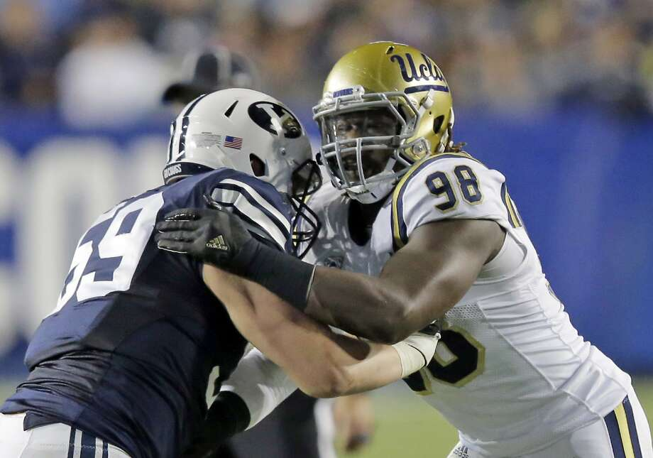 BYU offensive lineman Thomas Shoaf (59) blocks UCLA defensive lineman Takkarist McKinley (98) in the second half during an NCAA college football game Saturday, Sept. 17, 2016, in Provo, Utah. (AP Photo/Rick Bowmer) Photo: Rick Bowmer, Associated Press