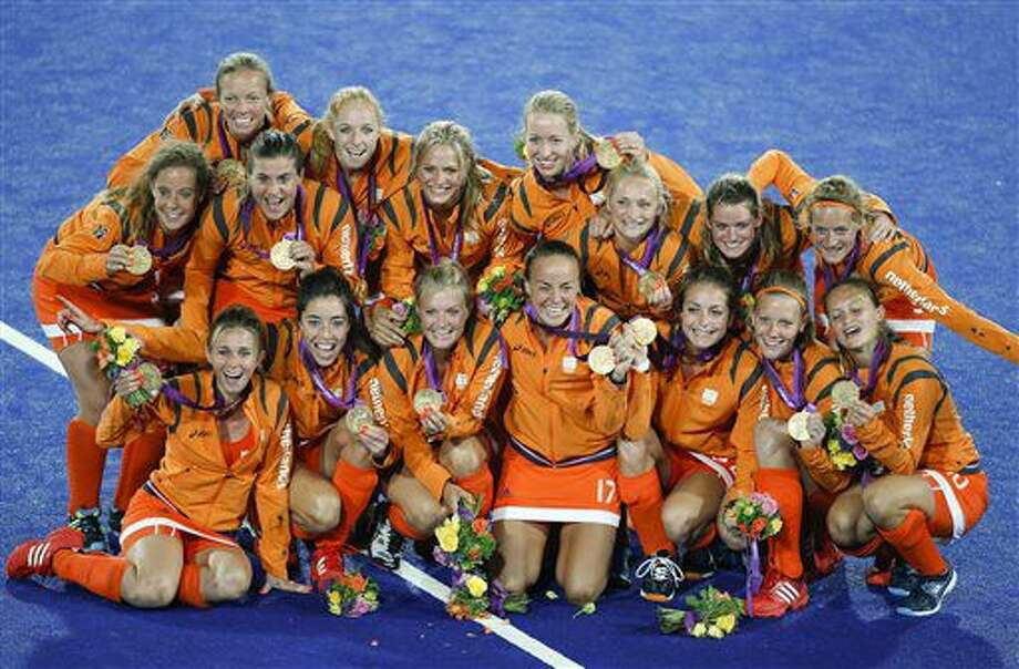 FILE - In this Aug. 10, 2012, file photo, the Netherlands' players pose with their gold medals after defeating Argentina in a women's field hockey match at the Summer Olympics, in London. The women's team is seeking its third consecutive Olympic gold medal. The small nation between Belgium and Germany has put up big field hockey results for nearly a century, and the sport holds a significant place in its culture. (AP Photo/Jae C. Hong, File) Photo: Jae C. Hong