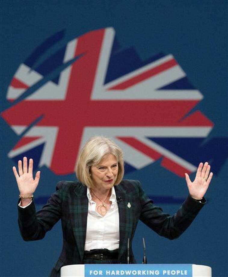 """FILE - This Sept. 30, 2013 file photo shows Theresa May. Britain's Conservative Party has confirmed that Theresa May has been elected party leader """"with immediate effect"""" and will become the country's next prime minister. Prime Minister David Cameron has said he will step down on Wednesday July 13, 2016 and May will immediately replace him. (Stefan Rousseau/PA via AP) Photo: Stefan Rousseau"""